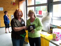 Val with the winner of the Bag of Paydirt donated by Dirt Hogg